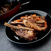 Braised beef ribs with carrots, celery and onions