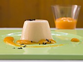 Ginger cream pudding with mango puree and sesame seeds