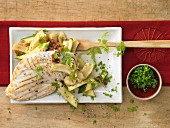 Grilled chicken breast with artichoke and courgette