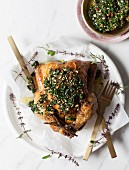 Lemon and herb roasted chicken with hand-chopped, kale-and almond pesto