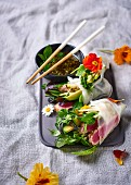 Rice paper rolls with tuna, avocado, apple and herbs