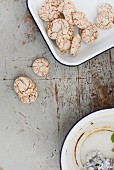Biscuits in and next to dish on worn tabletop