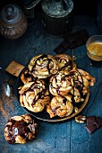 Swirl buns with a chocolate and cinnamon filling, chocolate sauce and walnuts