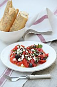 Beefsteak tomatoes with sheep's cheese and olives