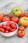 Various tomato varieties in and beside a bowl