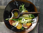 Stewed leeks with orange and grapefruit in a vinaigrette