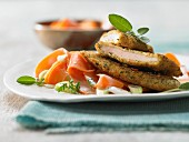 Chicken slices with a herb crust and aniseed carrots