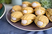 Madeleines filled with cream and a pearl for a maritime themed party