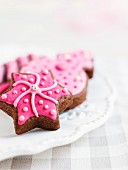 Chocolate Christmas biscuits with pink icing