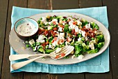 Broccoli and grean peas salad with blue cheese and crispy bacon