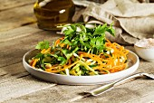 Vegetable salad with carrot, courgette, chickpeas and parsley