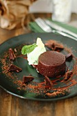 A small chocolate cake with mint ice cream