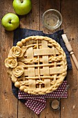 Apple pie with a dough lattice and roses