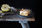 A piece of apple cake on a rustic stool