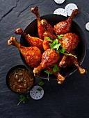 Glazed corn fed chicken drumsticks with a tamarind dip