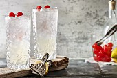 Tom Collins with cocktail cherries
