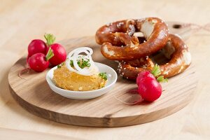 Bavarian snack: Obatzda with radishes and pretzel