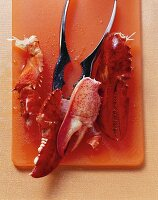 Pieces of lobster with tongs