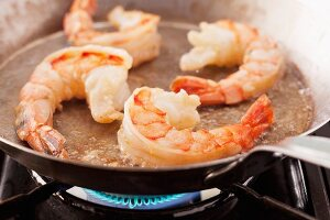 King prawns being fried