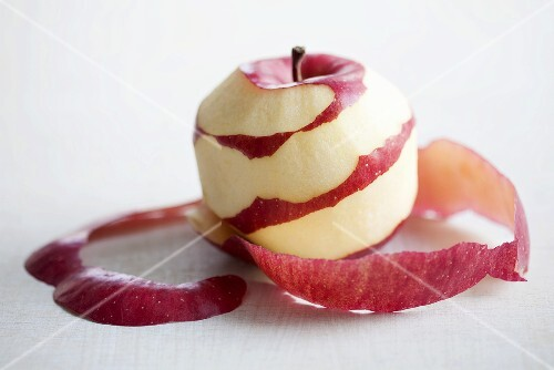A red apple, partially peeled