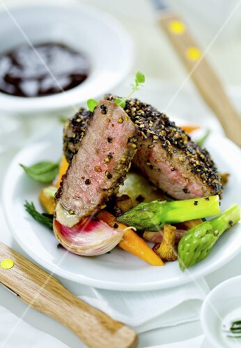 Grilled Argentinian beef with spring vegetables and chanterelle mushrooms