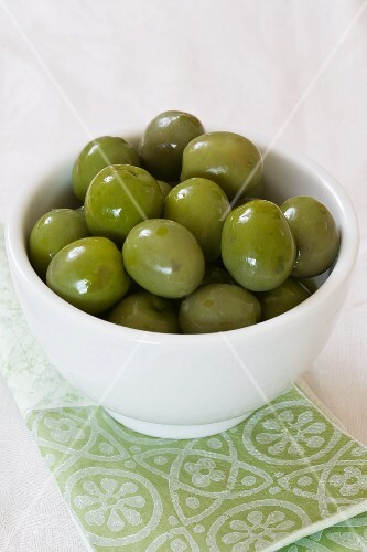 A bowl of green olives