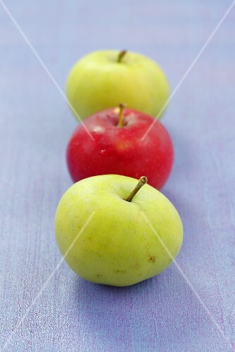 Three apples (two green, one red)