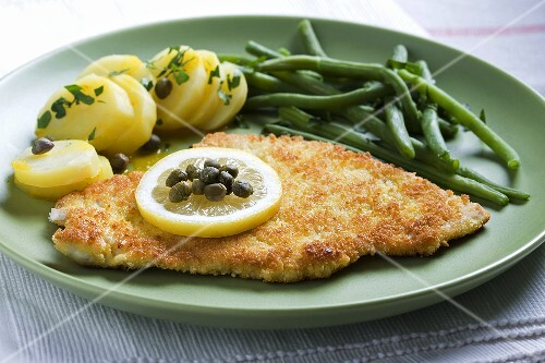 Bread turkey escalope with potatoes, capers and beans