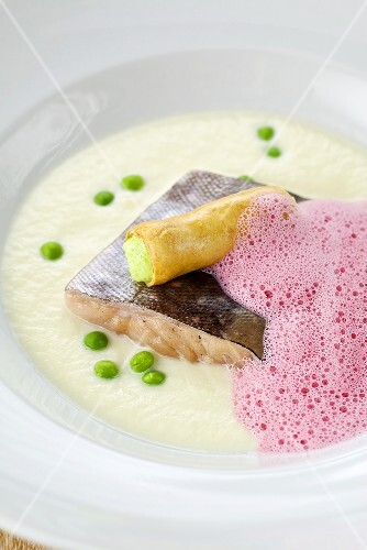 Salmon trout fillet in potato cream with beetroot foam and a wasabi roll