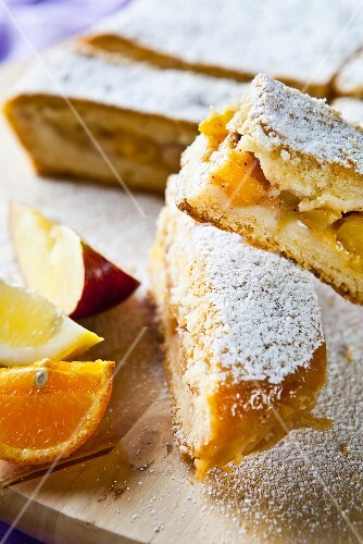 Fruit cake with apple, orange and lemon