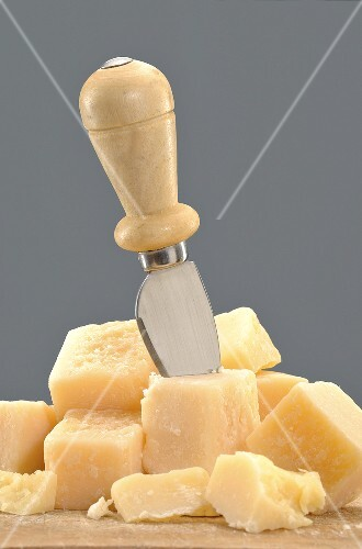 Parmesan cubes with cheese knife