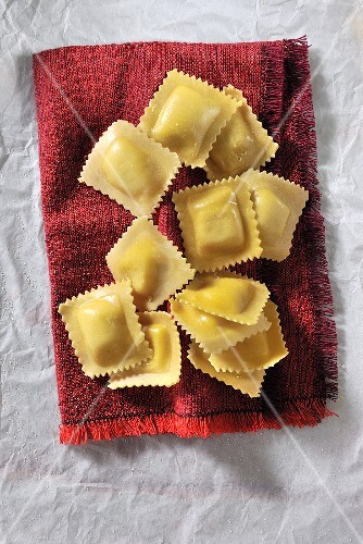 Ravioli on a red cloth