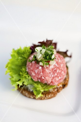 A canape with raw minced meat and onions