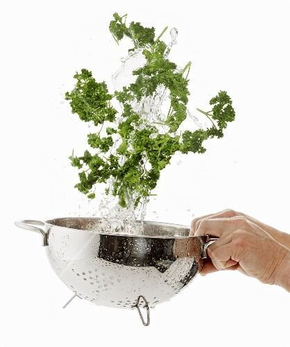 Parsley being washed