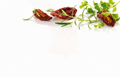 Dried tomatoes and various herbs