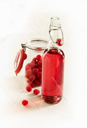 Fresh raspberries and a bottle of raspberry liqueur