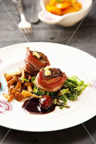 Beef fillet wrapped in bacon with chanterelle mushrooms and savoy cabbage