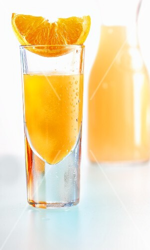 An orange juice shooter