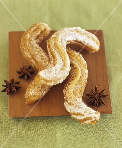 Churros (Spanish fried pastries) with star anise