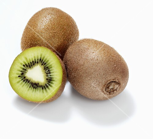 Kiwi fruits and half a kiwi fruit