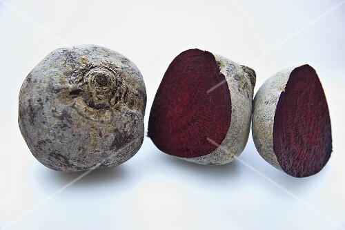 Whole and halved beetroot