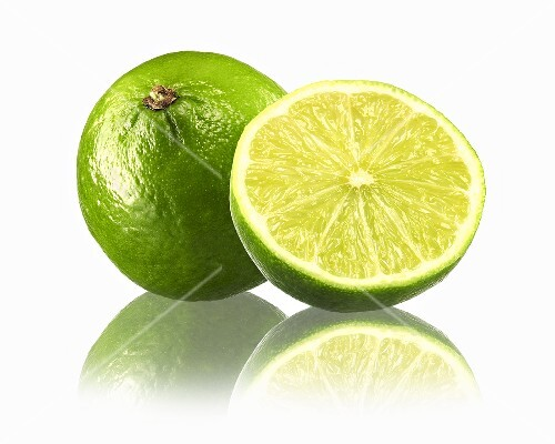 Whole lime and half a lime with reflection