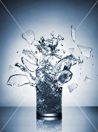 A glass of water shattering