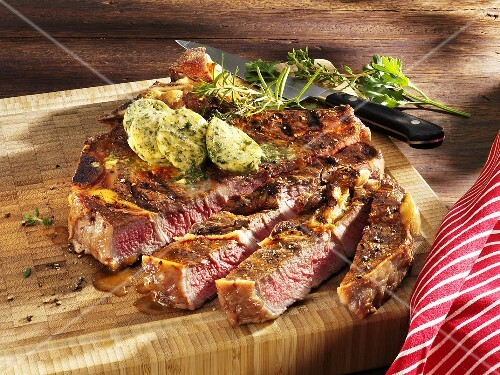 Grilled Porterhouse steak with herb butter