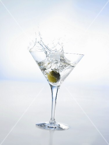 Martini with green olive (splash)