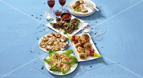 Assorted party snacks on plates