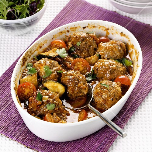 Oven-baked lamb meatballs with tomatoes and courgettes