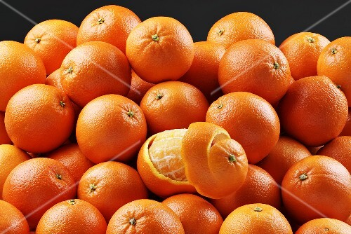 Lots of oranges, some peeled