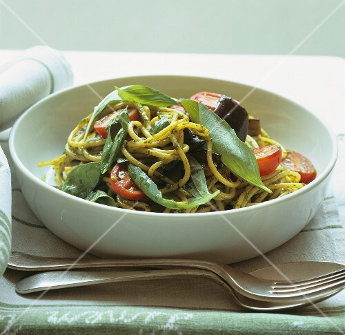 Spaghetti with aubergine, tomato and basil pesto