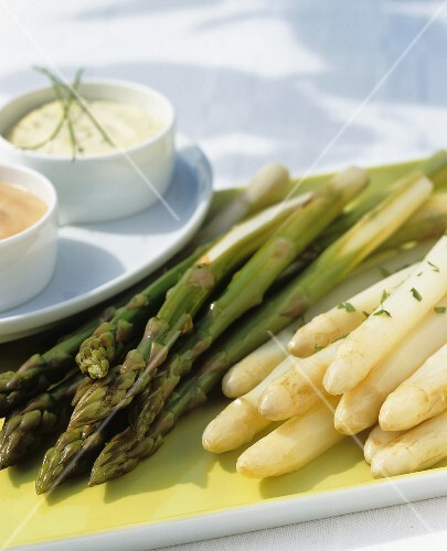 Green and white asparagus with two different sauces